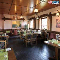 Salle du petit-djeuner situe dans le restaurant Berkheimer Hof Fotos