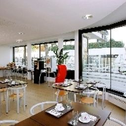 Sala de desayuno Appart City Le Port Marly Residence Hoteliere Fotos