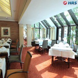 Breakfast room within restaurant Best Western Premier Arosa Fotos