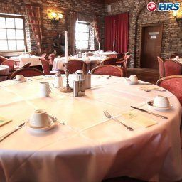 Breakfast room within restaurant De Poort Sporthotel Fotos