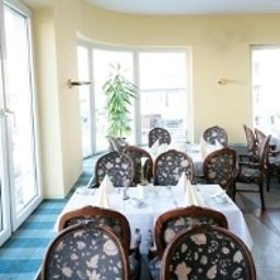 Breakfast room within restaurant Central Garni Fotos