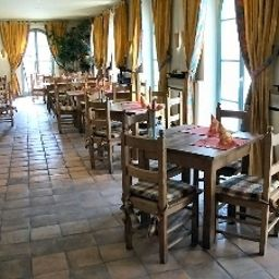 Breakfast room within restaurant Albergo Fotos