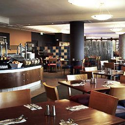 Sala de desayuno en el restaurante Swiss Grand Resort and Spa Fotos