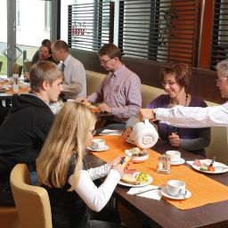 Breakfast room Global Inn Fotos